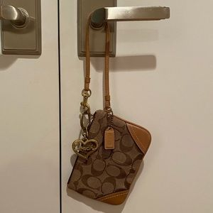 Coach wristlet in classic pattern, gold hardware